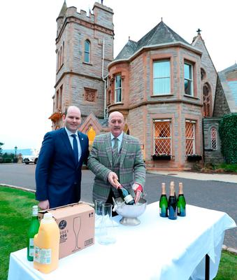 General Manager Garrett Power (left) and concierge Trevor Kelso prepare champagne at The Culloden Estate and Spa in Holywood, Belfast. Photo: Liam McBurney/PA Wire