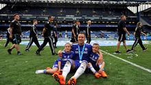 Chelsea's John Terry celebrates with family after winning the Barclays Premier League