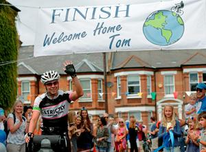 Tom Davies, 19, who claims to be the youngest person to have cycled around the world as he arrives back in London to his home in Battersea, on the final leg of his epic 18,000-mile journey. PRESS ASSOCIATION Photo. Picture date: Sunday August 9, 2015. Battling wind, rain and snow, he has notched up 100 miles of cycling a day to complete his trip, and raised nearly ?50,000 for charities. See PA story CHARITY Cyclist. Photo credit should read: Yui Mok/PA Wire