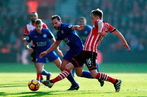 Southampton's James Ward-Prowse is challenged by Leicester City's Danny Drinkwater. Photo credit: David Davies/PA Wire
