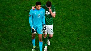 Ireland players Gavin Bazunu, left, and Dara O'Shea leave the pitch after their side's defeat to Luxembourg in the FIFA World Cup 2022 qualifying Group A match at the Aviva Stadium in Dublin. Photo by Piaras Ó Mídheach/Sportsfile