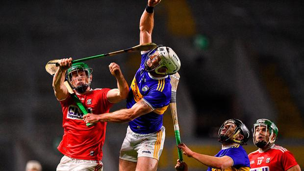 Pádraic Maher of Tipperary wins a high ball over Seamus Harnedy of Cork during the Allianz Hurling League Division 1 Group A Round 2 clash at Páirc Uí Chaoimh. Photo: Eóin Noonan/Sportsfile