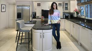 """TV star Glenda Gilson in her kitchen with its hand-painted units, granite worktop and Miele oven. """"We both cook, but Rob is the better of the two,"""" Glenda says Photo: Tony Gavin"""