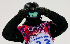 Ireland's Seamus O'Connor reacts after crashing during the men's snowboard halfpipe semi-final event at the 2014 Sochi Winter Olympic Games, in Rosa Khutor February 11, 2014