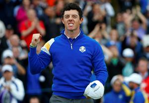 European Ryder Cup player Rory McIlroy celebrates as he wins 5&4 on the 14th green against U.S. Ryder Cup player Rickie Fowler during the 40th Ryder Cup singles matches at Gleneagles in Scotland September 28, 2014.    REUTERS/Eddie Keogh (BRITAIN  - Tags: SPORT GOLF)