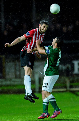 Aaron Barry, Derry City, in action against Mark O'Sullivan, Cork City