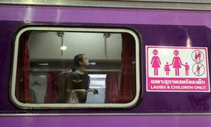 A passenger looks for her seat on a train carriage for women and children at Hua Lamphong train station in Bangkok, Thailand, The State Railway of Thailand introduced a womens-only carriage on main routes for overnight trains following the rape and murder of a 13-year-old girl on an overnight train in July