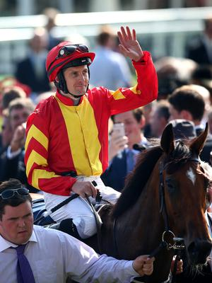 Colm O'Donoghue, seen here after partnering Qualify to victory in the Epsom Oaks, is still unsure if he will ride in the Irish Derby