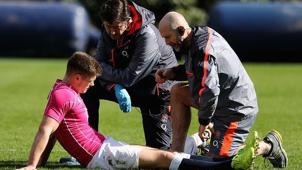 BAGSHOT, ENGLAND - MARCH 09:  Owen Farrell, the England centre, receives attention from England physio Phil Pask (R) and Rob Young, the team doctor during the England training session held at Pennyhill Park on March 9, 2017 in Bagshot, England.  (Photo by David Rogers/Getty Images)