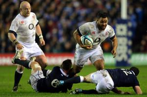 England's Billy Vunipola (centre) barges past Scotland's Chris Fusaro (grounded left) and Scotland's Matt Scott