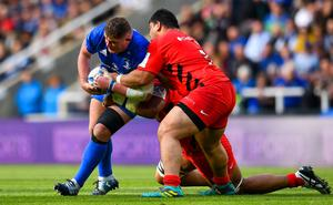 Tadhg Furlong of Leinster is tackled by Titi Lamositele of Saracens