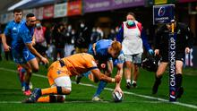 Ciarán Frawley of Leinster scores his side's second try despite the tackle of Mohamed Haouas of Montpellier during the Heineken Champions Cup Pool A Round 1 match at the GGL Stadium in Montpellier, France. Photo: Harry Murphy/Sportsfile