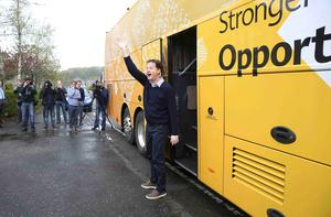 Leader of the Liberal Democrat party Nick Clegg waves to young children as he leaves the Westerton nursery during a campaign event in Glasgow, Scotland, Britain May 6, 2015.  REUTERS/Paul Hackett