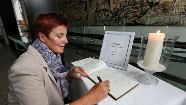 Patricia Howe, from Bray, Co Wicklow, signing the Book of Condolence at the Town Hall in Dun Laoghaire. Photo: Steve Humphreys