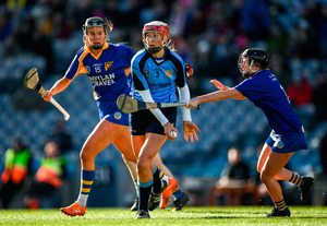 Margo Heffernan of Gailltír in action against Kate Kenny, left, and Sinéad Hanamy of St Rynagh's. Photo by Harry Murphy/Sportsfile