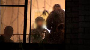 Police are seen inside a house during a raid in Sydney, in this still image taken from a police handout video September 18, 2014. REUTERS/Australian Federal Police Handout via Reuters TV