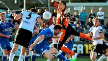 Dundalk's Brian Gartland, no.3, heads in his side's second goal