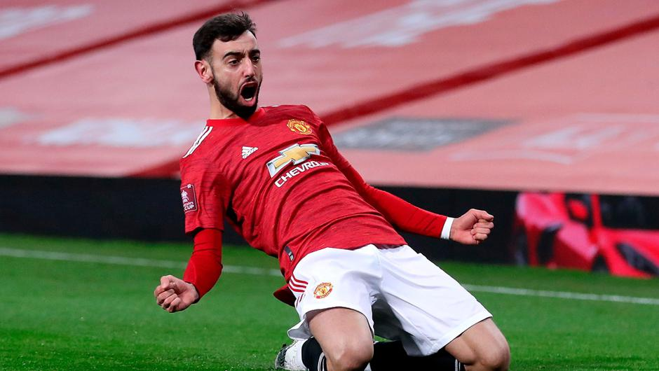 Bruno Fernandes of Manchester United celebrates after scoring his side's winning goal. (Photo by Martin Rickett - Pool/Getty Images)