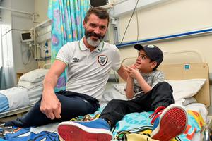 Republic of Ireland assistant manager Roy Keane with Alex O'Keeffe, age 6, from Tallaght, Co. Dublin, during a visit to Temple Street Childrens Hospital, Dublin. Picture credit: David Maher / SPORTSFILE