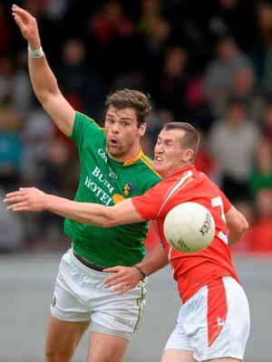 27 June 2015; Donal Wrynn, Leitrim, in action against Dessie Finnegan, Louth. GAA Football All-Ireland Senior Championship, Round 1B, Louth v Leitrim. County Grounds, Drogheda, Co. Louth. Picture credit: Piaras Ó Mídheach / SPORTSFILE