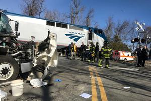 Emergency first responders work at the scene of the crash where an Amtrak passenger train carrying Republican members of the U.S. Congress from Washington to a retreat in West Virginia collided with a garbage truck in Crozet, Virginia, U.S. January 31, 2018.   Justin Ide/Crozet Volunteer Fire Department/Handout via REUTERS