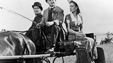 John Wayne, Barry Fitzgerald as chaperone, and Maureen O'Hara, at the beginning of the courting in The Quiet Man, 1952.
