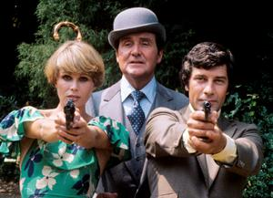 Joanna Lumley, who plays Purdey, Patrick MacNee, who plays John Steed and Gareth Hunt, who plays Mike Gambit, during filming of The Avengers. Photo: PA Wire