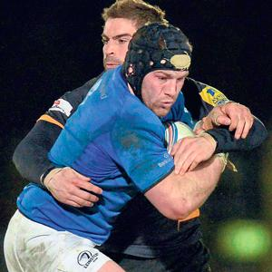 BUZZ OFF: Leinster's Sean O'Brien brushes off a challenge from a Wasps' player. The London side is now 98 per cent-owned by Irish entrepreneur Derek Richardson