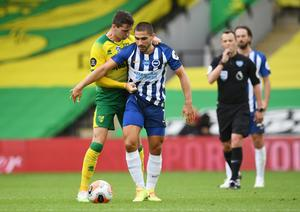 Norwich City's Kenny McLean clashes with Brighton & Hove Albion's Neal Maupay. Photo: Joe Giddens/Pool via Reuters