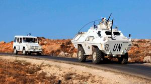 Vehicles of a convoy United Nations Interim Forces in Lebanon (UNIFIL) ride on a road along the border between Lebanon and Israel near the southern Lebanese town of Kfar Kila. Photo: ALI DIA/AFP via Getty Images