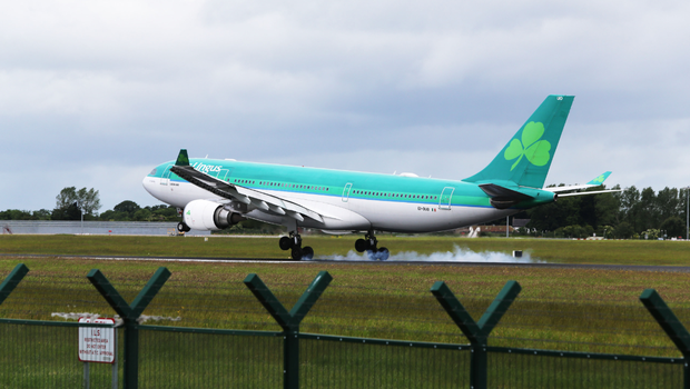 The Aer Lingus plane carrying the bodies of the young Irish students who lost their lives in the Berkeley tragedy landing at Dublin Airport. Photo: Mark Condren