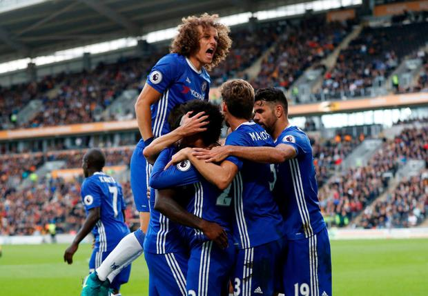 Chelsea's Willian celebrates scoring their first goal with team mates. Photo: Carl Recine/Action Images via Reuters
