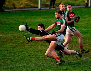 Aidan OShea of Mayo sees his kick blocked by Paul Kilcoyne of Sligo. Photo by Seb Daly/Sportsfile