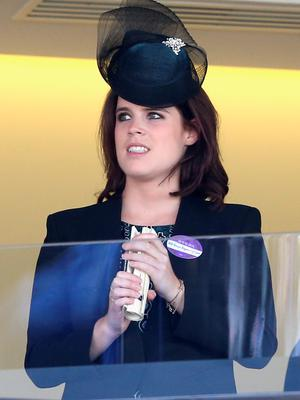 ASCOT, ENGLAND - JUNE 18:  Princess Eugenie watches the Queen's horse in the final race as they attend Ladies Day on day 3 of Royal Ascot at Ascot Racecourse on June 18, 2015 in Ascot, England.  (Photo by Chris Jackson/Getty Images)