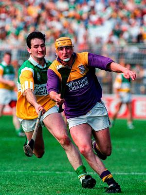 AWAY: Wexford's Garry Laffan shows Offaly's Kevin Kinahan a clean pair of heels during the 1996 Leinster SHC final. Pic: Sportsfile.