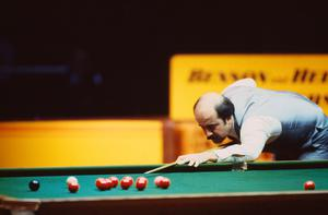 English snooker player Willie Thorne competing in the Masters tournament, Wembley Conference Centre, 1986.  Photo: Trevor Jones/Getty Images