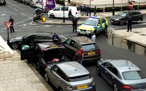 Caption: A witness picture of the police scene at Eaton Place, Belgravia, London