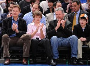 Liam Neeson, Michael Neeson, Aidan Quinn and Daniel Neeson attend New Jersey Nets vs New York Knicks game at Madison Square Garden on April 15, 2009 in New York City.  (Photo by James Devaney/WireImage)
