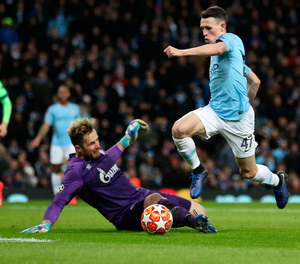 Manchester City's Phil Foden rounds Schalke goalkeeper Ralf Fahrmann to score his side's sixth goal of the game during the UEFA Champions League round of 16 second leg match at the Etihad Stadium, Manchester. PRESS ASSOCIATION Photo. Picture date: Tuesday March 12, 2019. See PA story SOCCER Man City. Photo credit should read: Martin Rickett/PA Wire