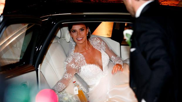 British TV personality Christine Bleakley smiles at her husband, former Chelsea and England soccer player Frank Lampard, after their wedding in London, Britain, December 20, 2015