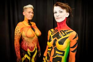 Agnieszka Malik, from Bray, Co Wicklow, and Claire Higgins, from Kildare, decorated with bodypaint at the Tattoo Convention in Dublin. Picture: Arthur Carron