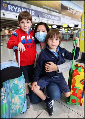 Ingrid Dessert and her children Theo (8) and Louis (4) who were travelling from Paris at Dublin Airport. Photo by Steve Humphreys