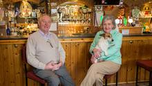 Closed: Christy and Mary Ruane with their dog Alfie at their pub Ruane's in Glentane, Co Galway. Photo: Mark Condren