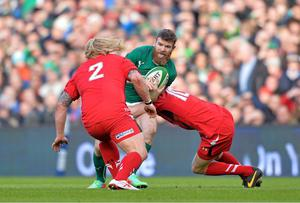 Gordon D'Arcy is tackled by Rhys Priestland and Richard Hibbard of Wales