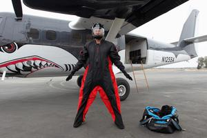 Wingsuit jumper Joby Ogwyn shows reporters his prototype wingsuit before taking a practice jump as he prepares to attempt the first wingsuit jump off the summit of Mount Everest in May near Perris, California