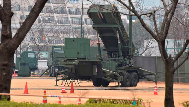 "A PAC-3 surface-to-air missile launcher unit (C), used to engage incoming ballistic missile threats, is seen in position at the Defence Ministry in Tokyo on March 6, 2017.  Three of the four missiles North Korea launched March 6 landed in Japanese-controlled waters, Prime Minister Shinzo Abe said, calling the development a ""new stage of threat"". / AFP PHOTO / KAZUHIRO NOGIKAZUHIRO NOGI/AFP/Getty Images"