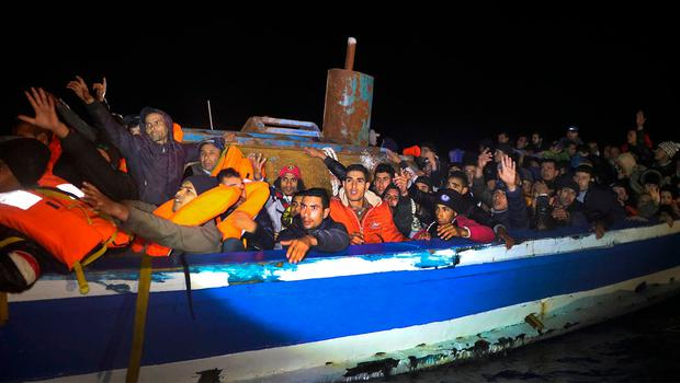 Migrants on board a drifting, overcrowded wooden boat react during a rescue operation by the Spanish NGO Proactiva Open Arms, north of the Libyan city of Sabratha in the Mediterranean Sea. Photo: Reuters