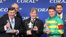 PA via Reuters Trainer Nicky Henderson, owner John P. McManus and jockey Barry Geraghty (right) celebrate after the Coral Cup Handicap Handicap Hurldle during day two of the Cheltenham Festival at Cheltenham Racecourse.