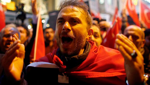People shout slogans during a protest in front of the Dutch Consulate in Istanbul, Turkey, early March 12, 2017. REUTERS/Osman Orsal