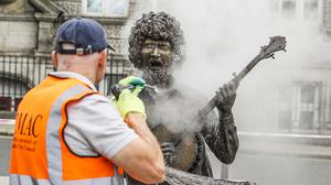 Man of the people: A worker cleans the statue of Luke Kelly on South King Street in Dublin. Photo: Mark Condren